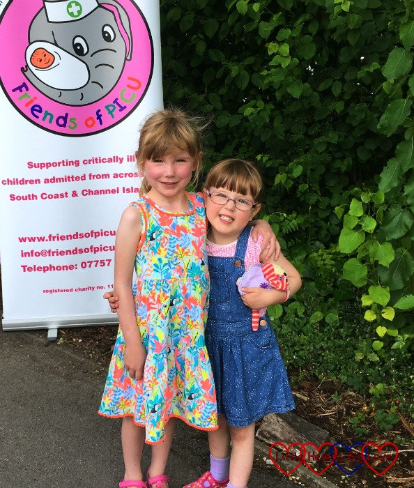 Two little girls at the Friends of PICU family fun day - both of whom have hypoplastic left heart syndrome