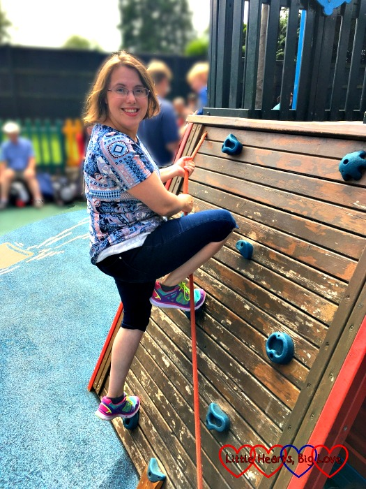 Climbing a climbing wall in a children's playground as part of the #bigkidsforGOSH campaign