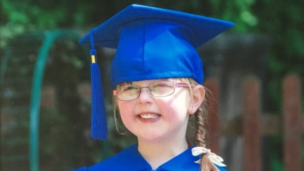 Jessica in her preschool graduation cap and gown