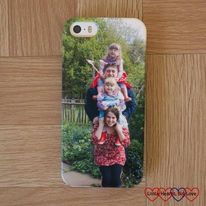 My new phone case from CaseApp with a totem-pole style photo of our family