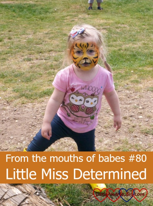 "Sophie with her face painted like a tiger and the text ""From the mouths of babes #80 - Little Miss Determined"""