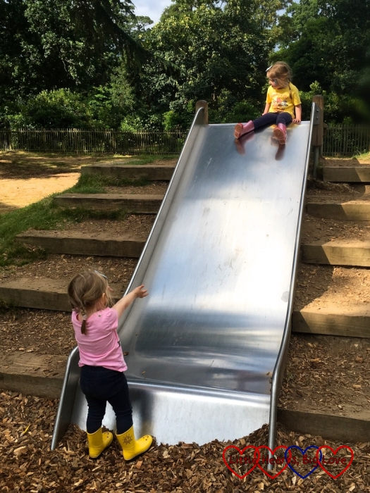 Sophie catching Jessica at the bottom of the slide