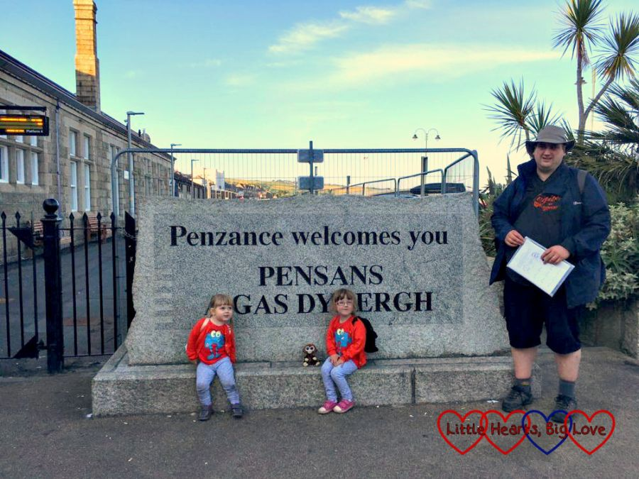 Hubby, Jessica and Sophie in front of the 'Penzance welcomes you' sign