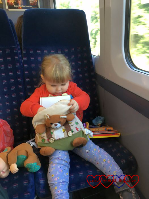 Sophie checking out the contents of her backpack on the train