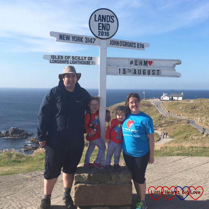 Hubby, me, Jessica and Sophie standing in front of the signpost at Land's End