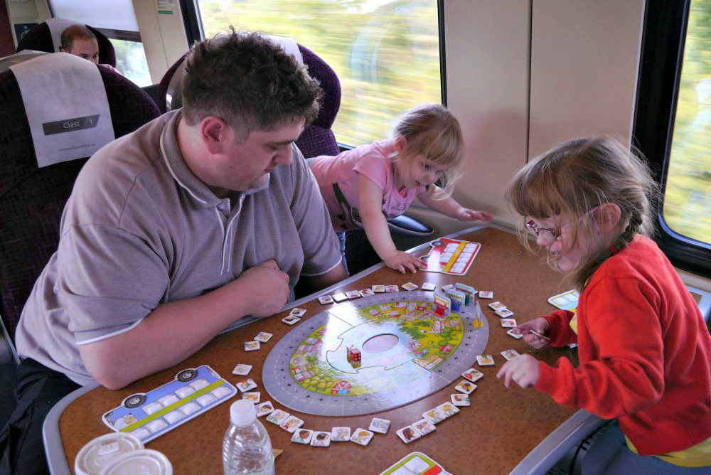 Playing Bus Stop together on the train