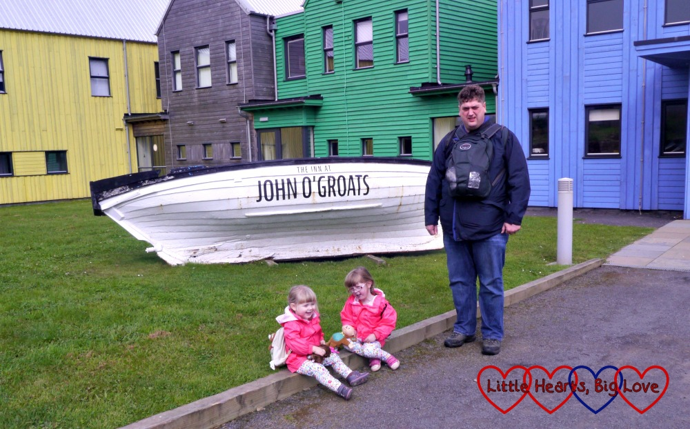 "Hubby, Jessica and Sophie standing next to a white boat with the words ""The Inn at John O'Groats"" painted on it"