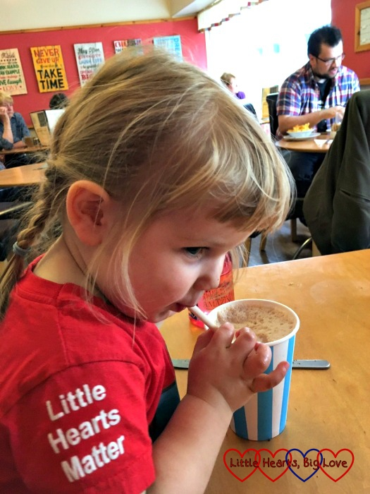 Sophie enjoying a milkshake at Morag's Cafe in Wick