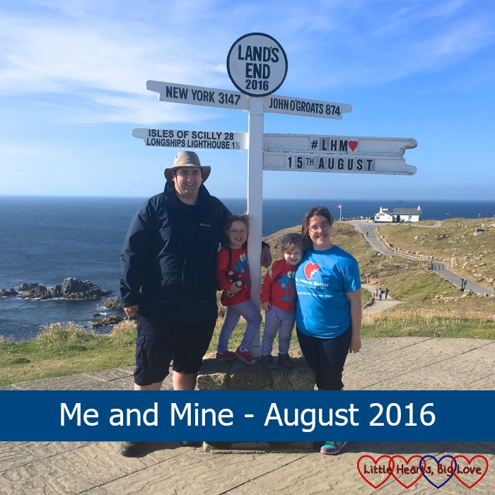 """Me, hubby, Jessica and Sophie standing at the Land's End signpost with the text """"Me and Mine - August 2016"""""""