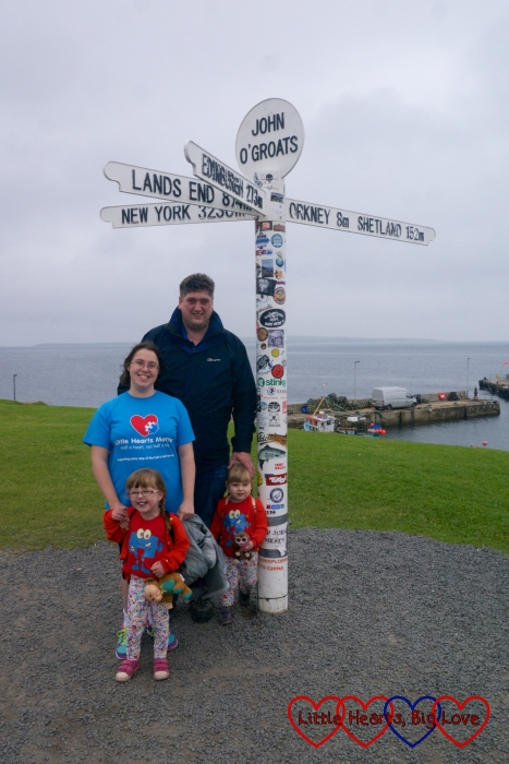 Me, hubby, Jessica and Sophie standing in front of the signpost at John O'Groats