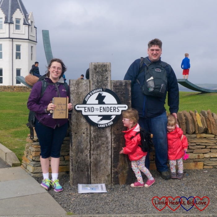 Me, hubby, Jessica and Sophie next to the End to Enders sign at John O'Groats