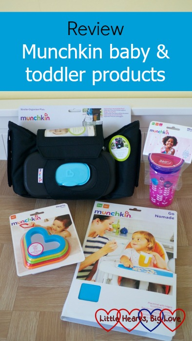"A selection of Munchkin products with the text ""Review - Munchkin baby and toddler products"""