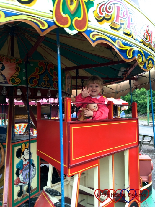 Sophie riding a bus on the roundabout