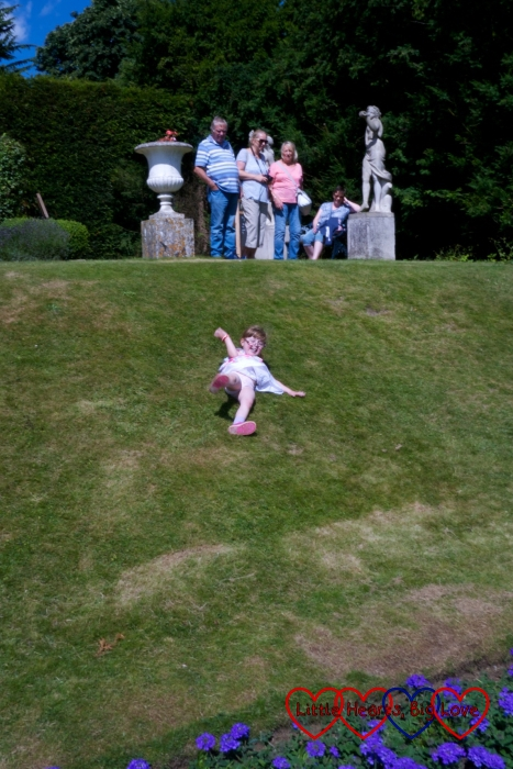 Jessica rolling down a hill at Hughenden Manor