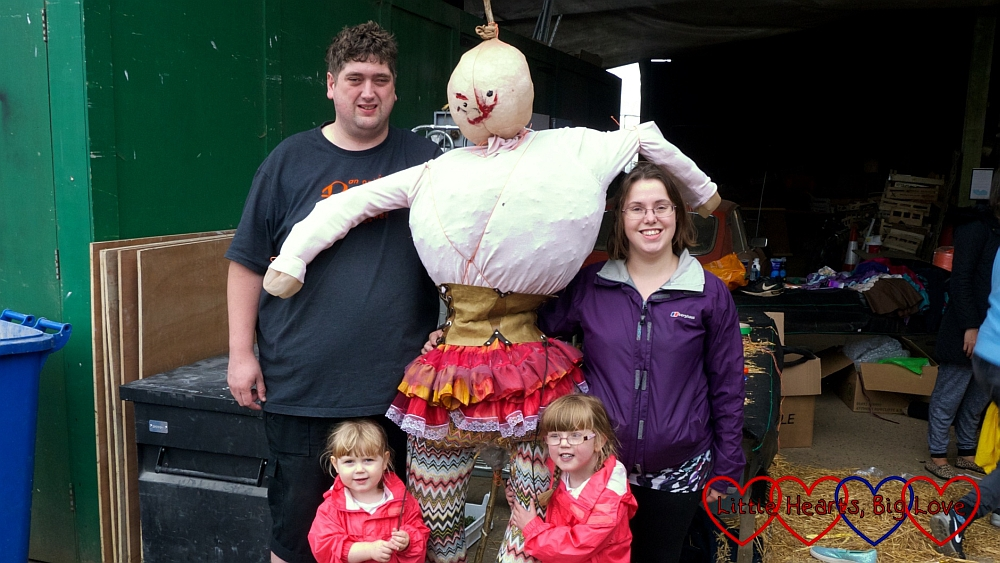 Me, hubby, Jessica and Sophie with the scarecrow we built