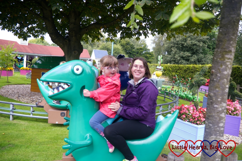Me and Jessica riding a dinosaur on the George's Dinosaur Adventure ride