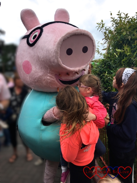 Ebony, Erin and Jessica meeting Daddy Pig at Peppa Pig World