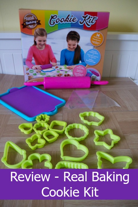 Real Baking Cookie Kit containing a rolling pin, dough guide, silicon baking mat, cookie cutters and a piping bag