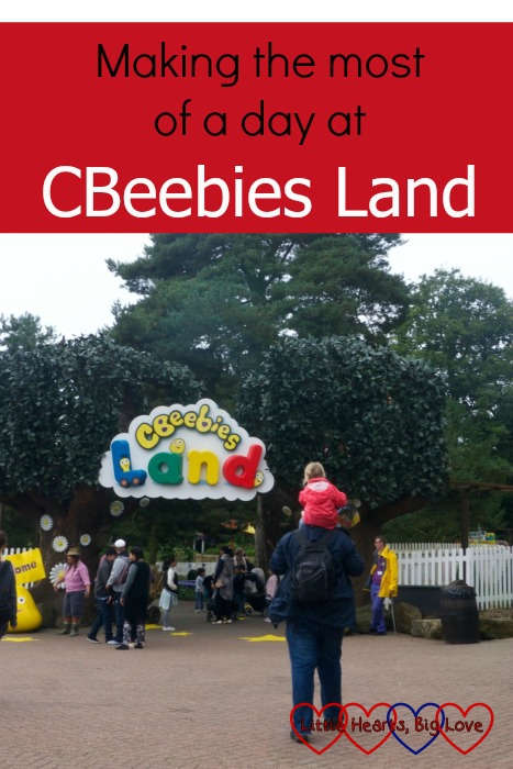 Sophie riding on Daddy's shoulders as they head towards the entrance to CBeebies Land: Making the most of a day at CBeebies Land