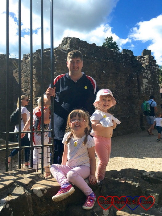 Hubby and the girls at the entrance to Kenilworth Castle