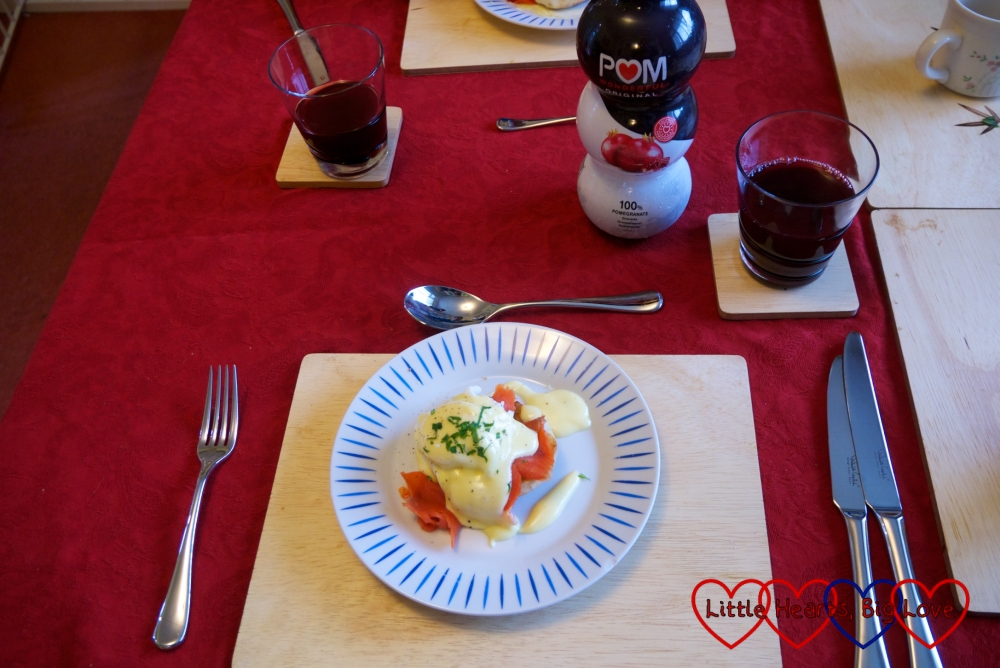 Eggs Royale - poached eggs with Hollandaise sauce and smoked salmon on a toaste muffin, served with POM Wonderful pomegranate juice