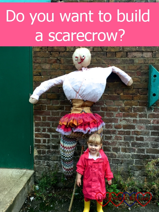 """Sophie standing next to the scarecrow we built - """"Do you want to build a scarecrow?"""""""