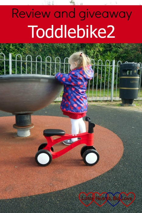 """Sophie at the park with her Toddlebike2 - with the text """"Review and giveaway - Toddlebike2"""""""