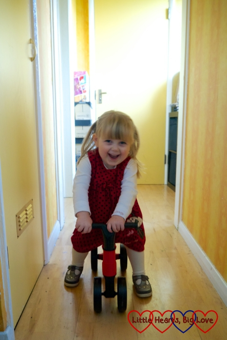 Sophie riding the Toddlebike2 down the hallway