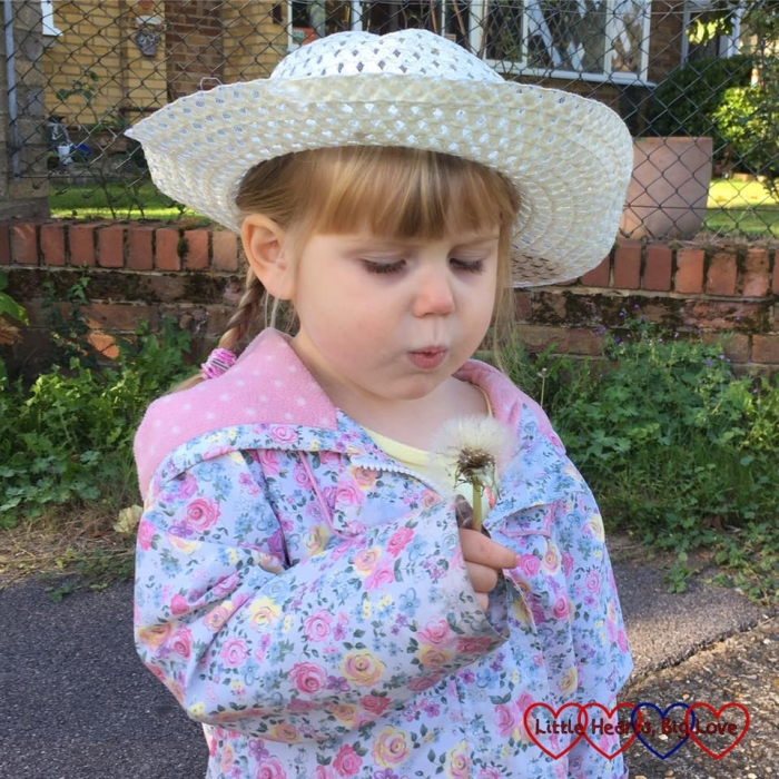 Sophie blowing a dandelion clock