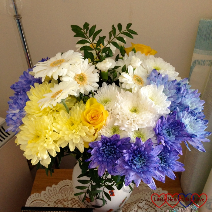 A pretty bunch of yellow, white and blue flowers