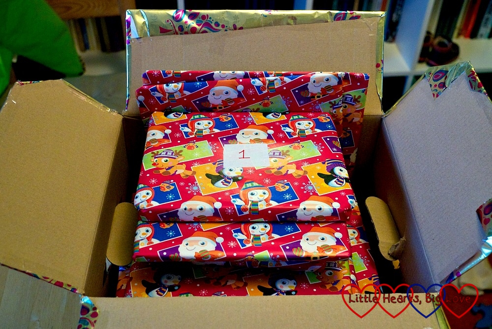 The books from the book advent calendar in a gift-wrapped box, ready to be opened