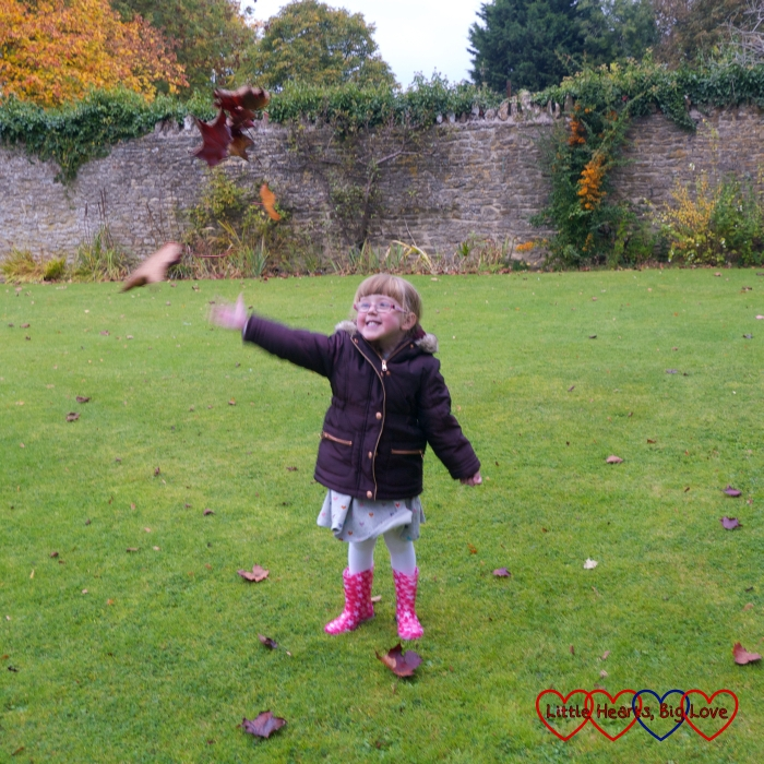 Jessica throwing leaves in the air