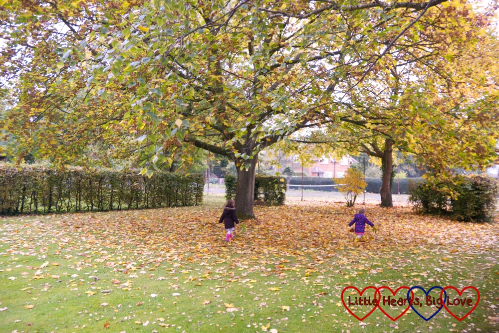 Jessica and Sophie running through fallen leaves