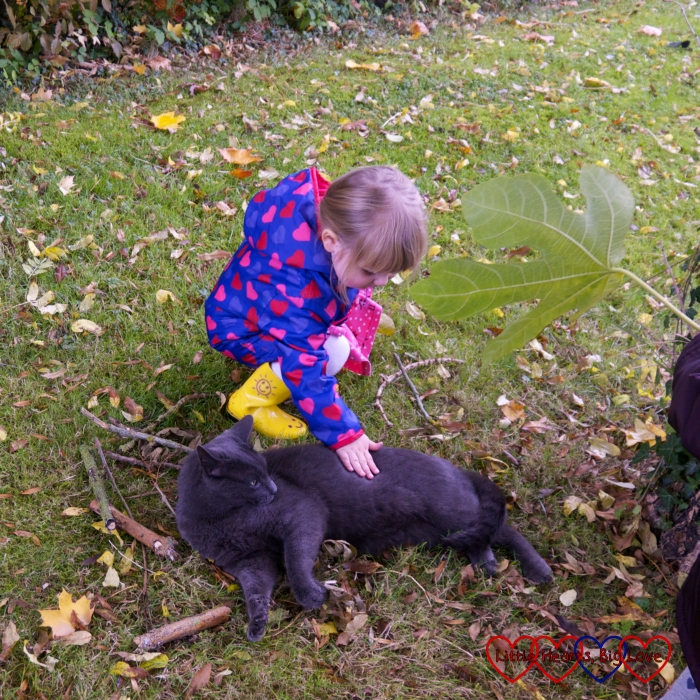 Sophie stroking a black cat