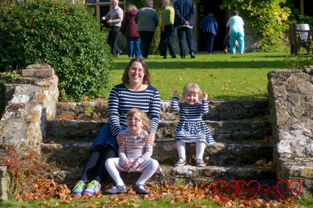 Me and my girls sitting on the steps outside Charney Manor