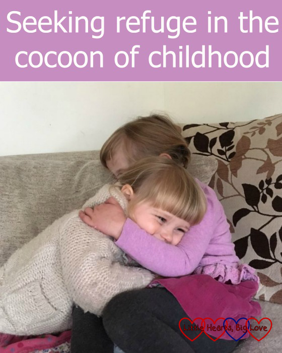 "Jessica and Sophie having a cuddle - ""Seeking refuge in the cocoon of childhood"""