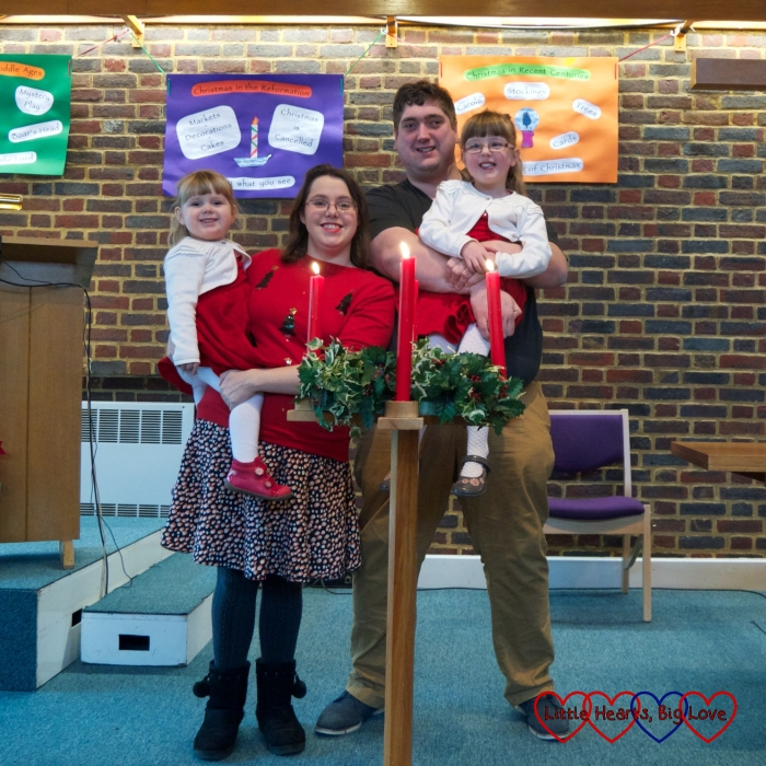 Me, hubby, Jessica and Sophie standing behind the advent candles at church