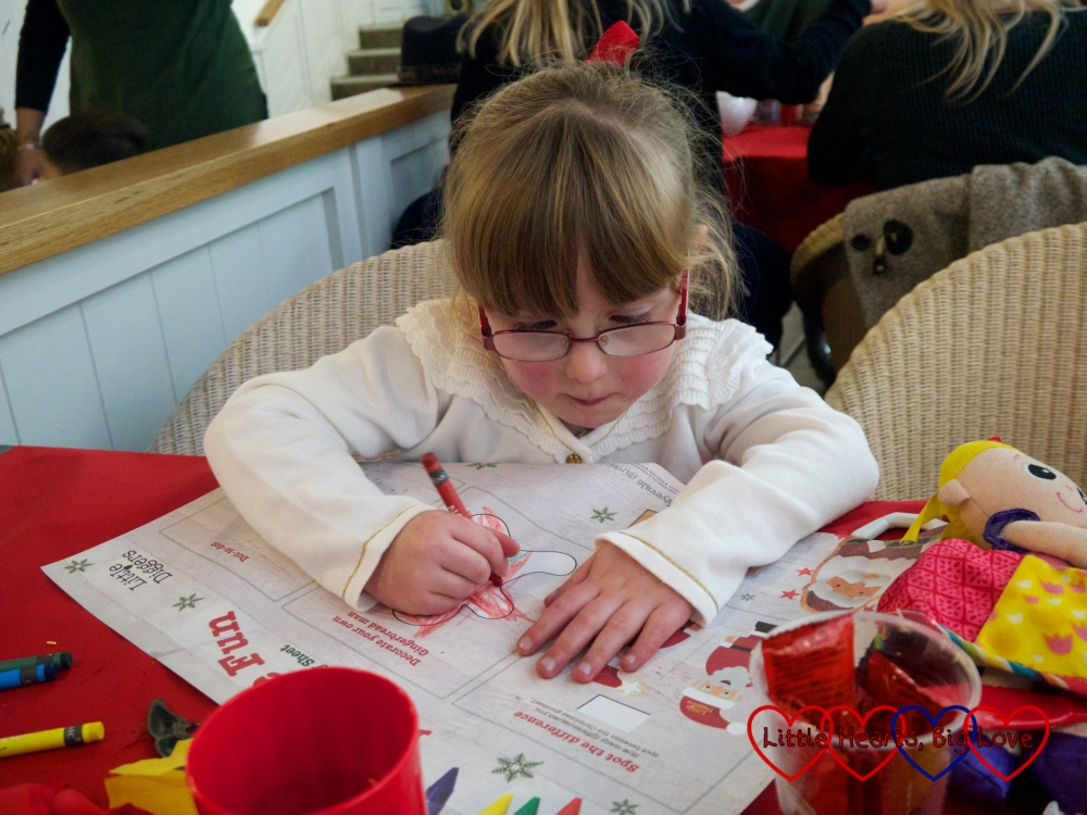 Jessica colouring in her activity sheet