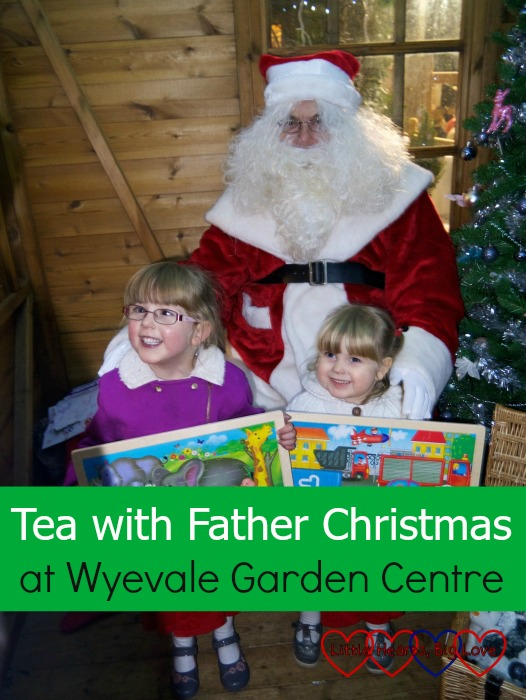 Jessica and Sophie pose with Father Christmas after having tea with him at a Wyevale Garden Centre