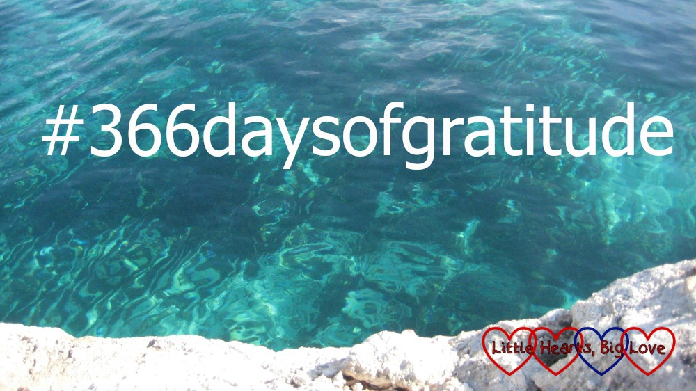 Blue waters of a lagoon with the text #366daysofgratitude