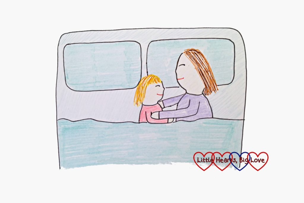 A drawing of a mummy and daughter asleep together in a bed