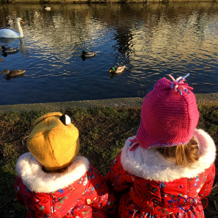 Jessica and Sophie watching the ducks and swans at the river