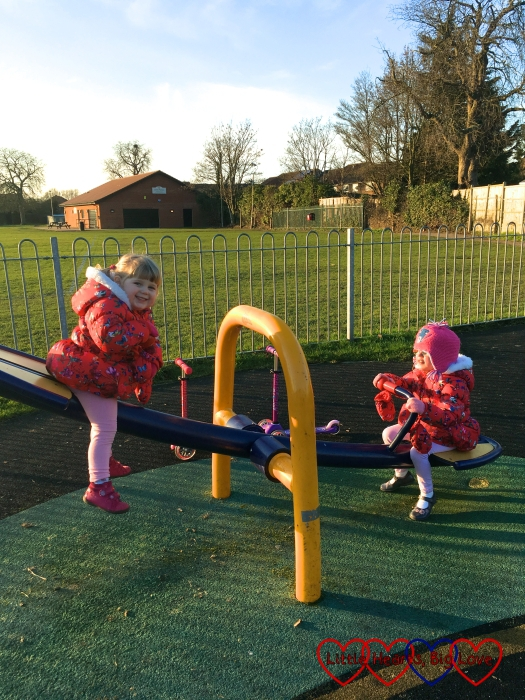 Jessica and Sophie on the seesaw at the park