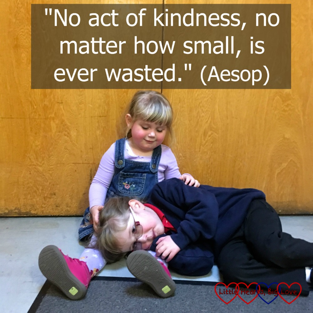 "Sophie sitting on the floor stroking Jessica's back with Jessica lying across Sophie's legs on the floor. ""No act of kindness, no matter how small, is ever wasted."" (Aesop)"