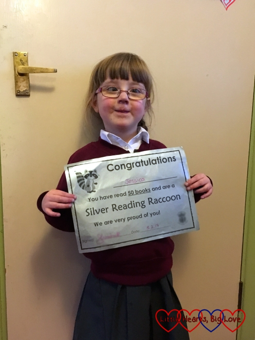 Jessica with her silver reading raccoon certificate