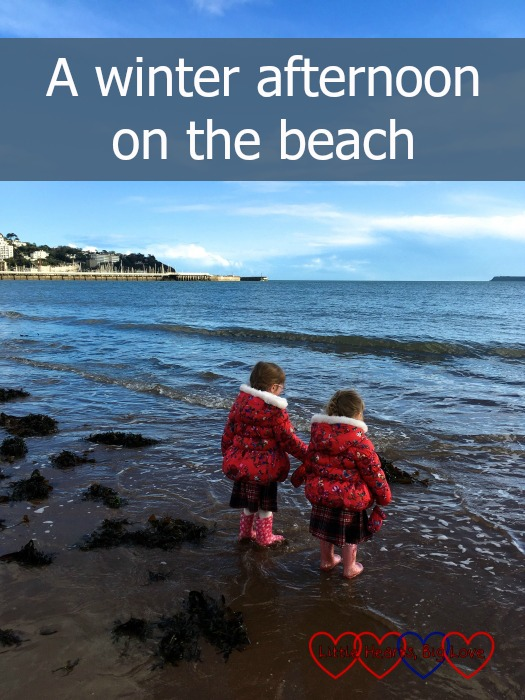Jessica and Sophie standing at the edge of the sea: A winter afternoon on the beach