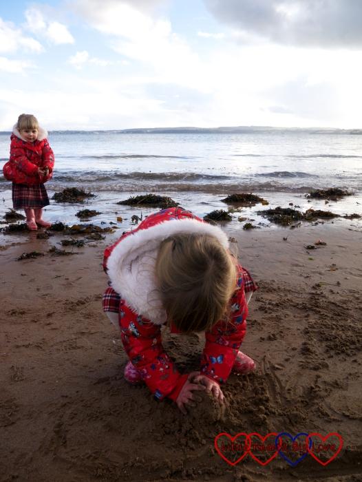 Jessica building a sandcastle