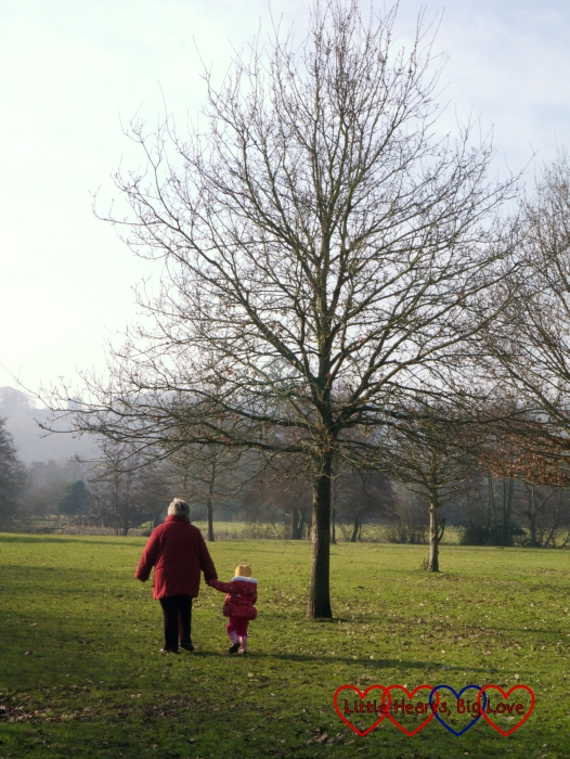 Sophie and Grandma walking across the field