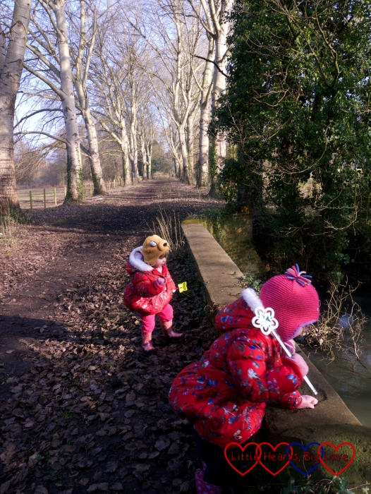 Jessica and Sophie trying to play Pooh sticks at the bridge