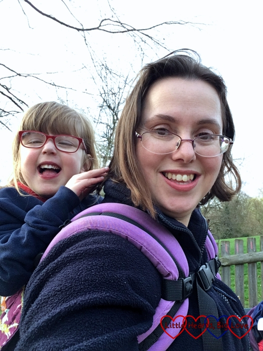 Jessica riding on my back in the toddler carrier